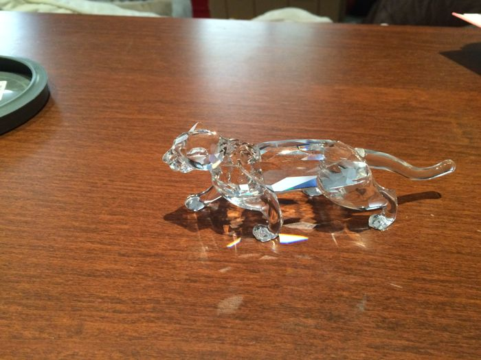 Lot of two pieces by Swarovski medium sizes (Panther) and small (Lion cub walking)