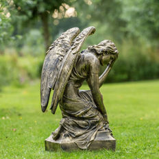 Bronze-coloured Angel in a Bend-Over Posture