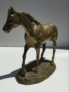 Sculpture of a horse, in brass.