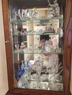 Swarovski - Collection of various Figurines - small Cabinet.