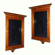 A rare pair of Charles X corner cupboards in birdseye maple and amaranth wood - early 19th century