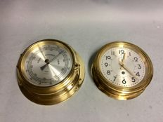 Brass ship's clock and brass ship's barometer