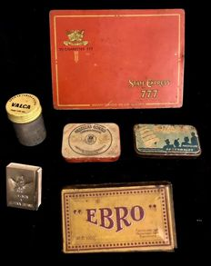 A collection of six tiny advertising boxes from early to mid 20th century