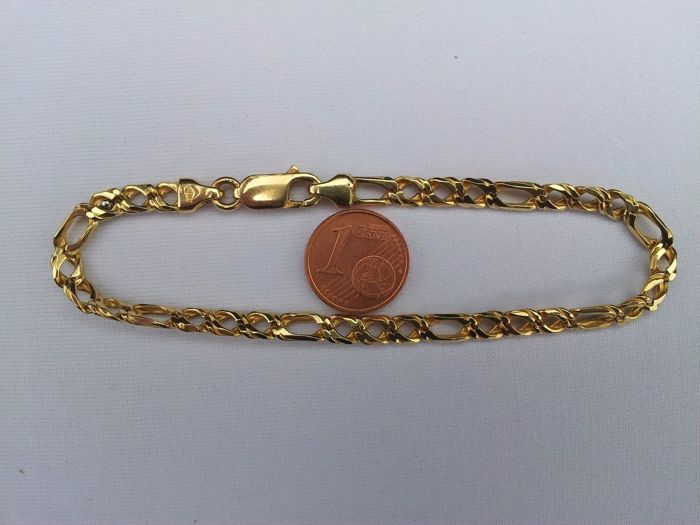 MI 12 Bracelet, 18 kt yellow gold. 12.31 grams – Length, 21 cm.