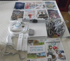 Nintendo Wii with 2 controllers and 10 games like Mario Kart