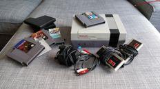 Nintendo NES with 4 games, 2 controllers