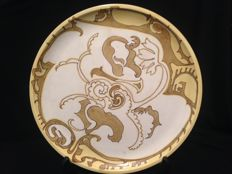 T.A.C. Colenbrander, Rozenburg Den Haag - An early and rare ochre (yellow) wall plate.