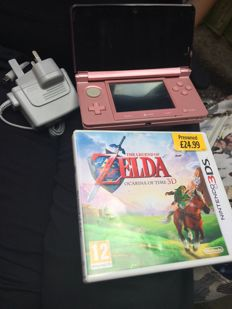 3DS with Zelda game and charger.