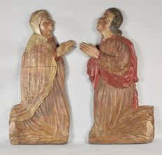 Two large wooden reliefs of a man and woman - South Europe - 16th century
