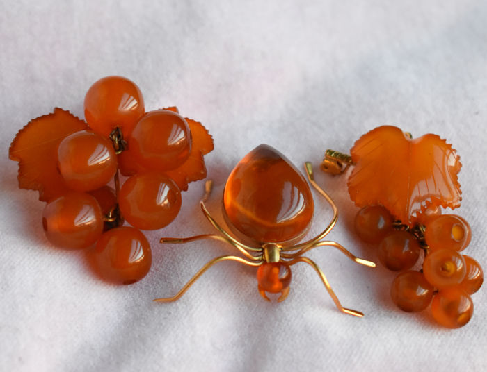 Three Russian Baltic amber pin brooches with Russian gold