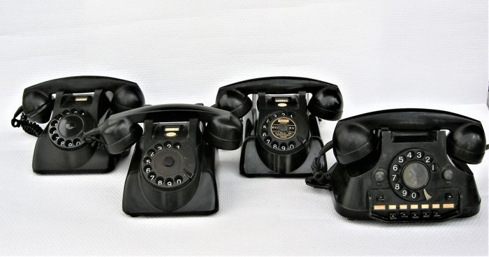 Four bakelite telephones