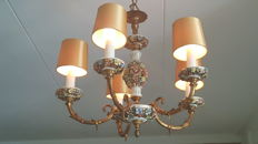 French chandelier with five copper arms and beautiful highly detailed porcelain items with flowers