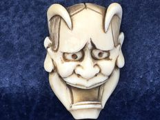 "An antique ivory Netsuke' of a Devil's head ""Hannya Mask"" - Japan - around 1900"