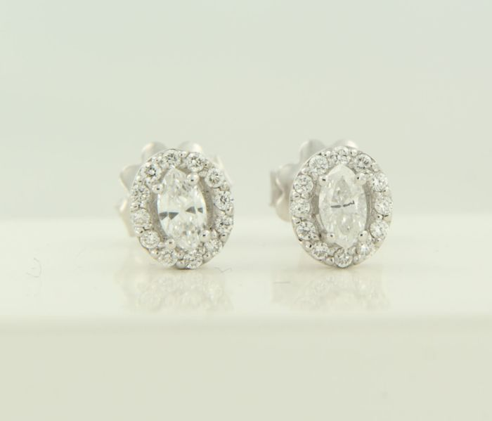14 kt white gold entourage ear studs set with a central marquise cut diamond and an entourage of brilliant cut diamonds