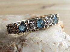 Gold Eternity ring with natural Diamond and Topaz.