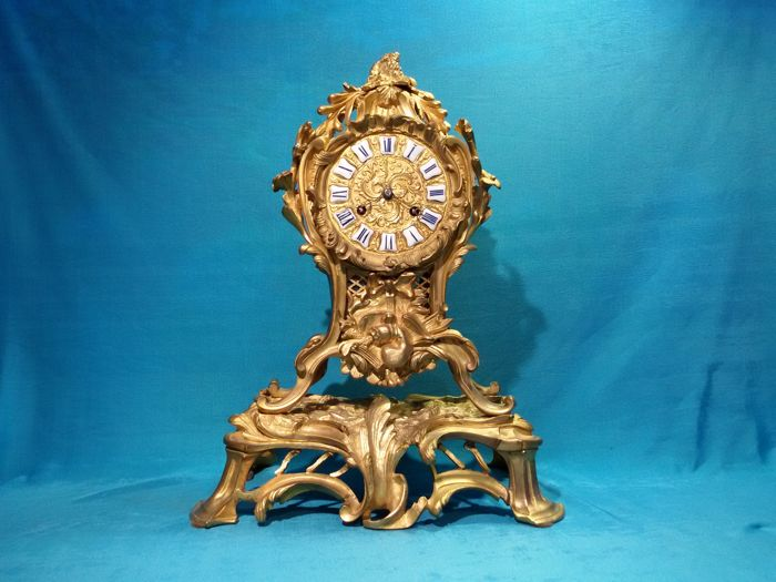 19th century Parisian table clock in gilt wood