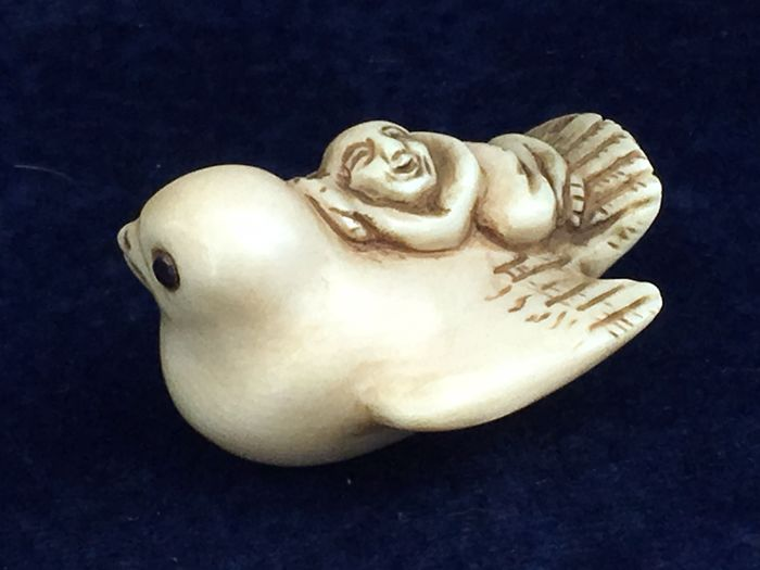 An ivory Netsuke of a fortune sparrow 'Fukura Suzume' with man on its back - Japan - circa 1920