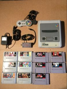 Super Nintendo Console complete with all cables and 6 Pal games and 5 NTSC games.