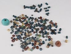 Ca. 200 multicolored faience beads.