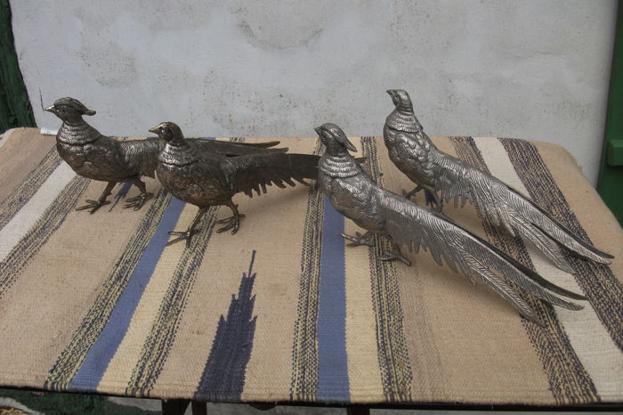 Two pairs of pheasants in silver plated metal for table centrepiece