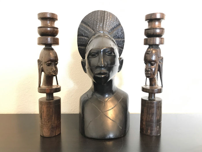 Large wood carving of African chief with candleholders - Africa - second half 20th century.