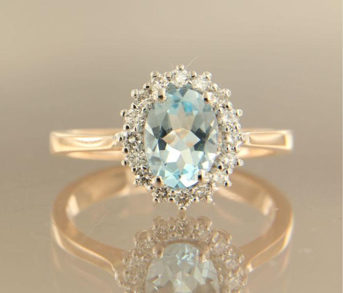 14 kt bi-colour gold entourage ring with 1.30 ct oval topaz and 16 brilliant cut diamonds, 0.28 ct – 54 (EU)