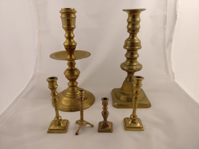 Six brass candlesticks, including four miniatures, Netherlands, late 19th century