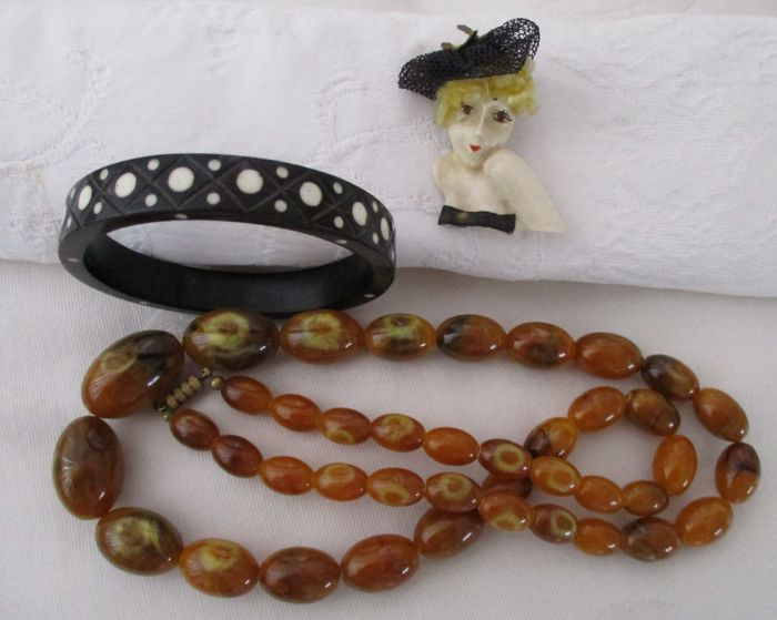 Lot of three celluloid jewellery circa 1935-1950 including, necklace, bracelet, brooch.