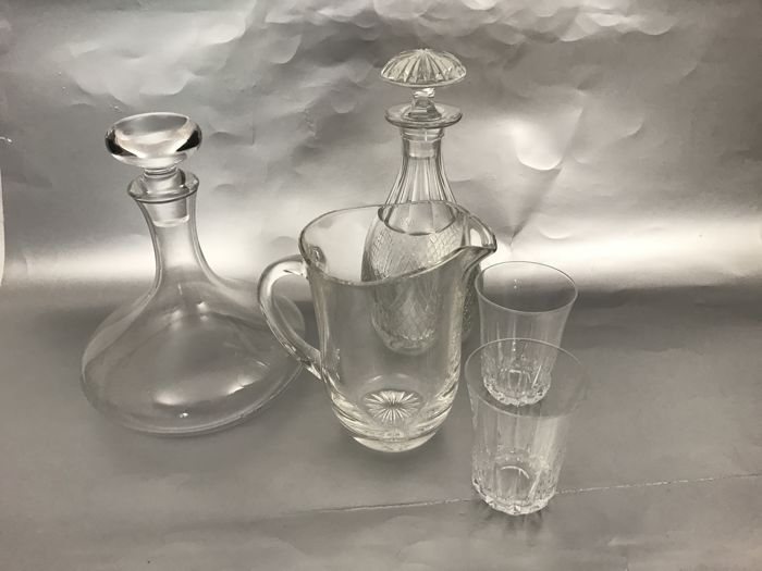 Two carafes, glass water jug and two glasses