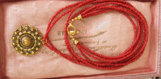 Four-strand precious coral necklace with pendant
