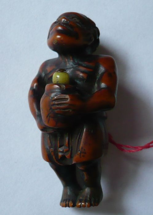 Old wooden netsuke. Man from the south seas (Kurombo) - Japan - 19th century