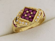 Yellow gold ring with rubies surrounded by diamonds