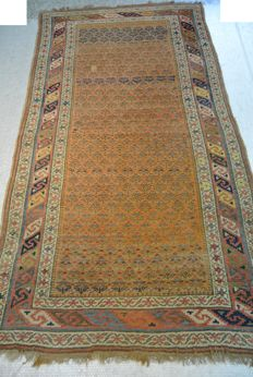Very old hand-knotted Persian carpet, over 100 years old, circa 250 x 132 cm. Beginning of the 20th century