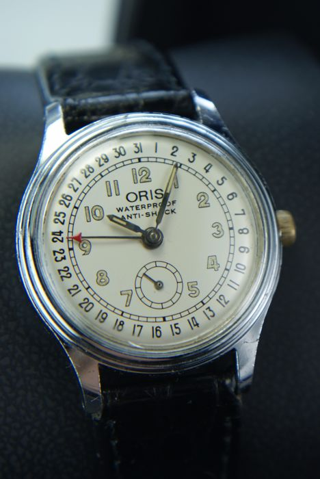 ORIS -    Pointer date calendar. Very rare vintage watch  Cal 704.    1960's