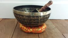 A carving singing bowl 23cm 1683g- Nepal - late 20th century