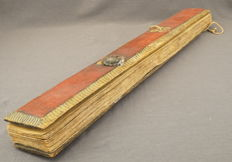 Book made of palm leaves, dozens of pages held together by wooden holder - India / Sri Lanka - presumably 1878.