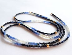 Necklace made of sapphire stones with 14 kt gold, length: 85.5 cm