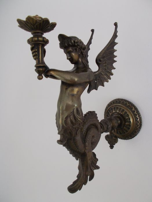 Bronze statue of a winged mermaid holding a torch, France, ca. 1930