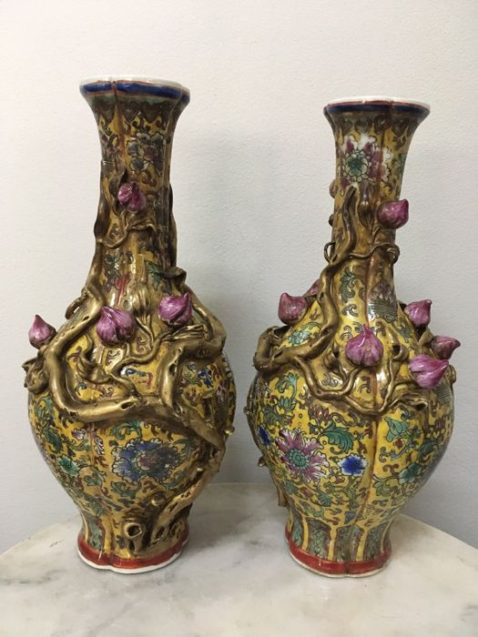 Pair of Porcelain Vase with bas relief Lotus flower - China - late 20th Century.