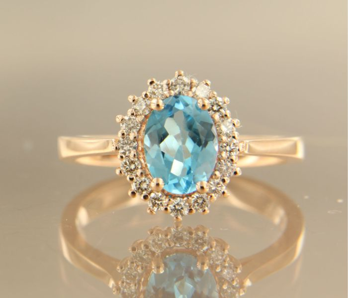 14k rose gold ring set with 1.20 ct topaz and 16 brilliant cut diamonds, approx. 0.28 ct in total, ring size 17.25 (54)