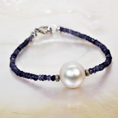 Bracelet with fine faceted Iolites and South Sea round pearl of 12 mm diameter