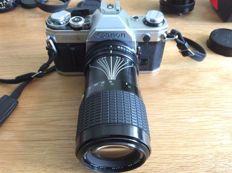 Canon AE-1 analogue SLR camera with lenses and accessories