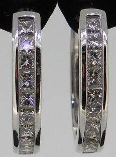 18 kt white gold earrings set with top quality princess cut diamonds 0.71 ct (channel setting)