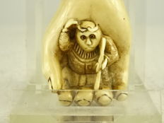 "Netsuke of "" Songoku / Sun Wukong"" the monkey king in Buddhas hand - Japan - ca. 1930"