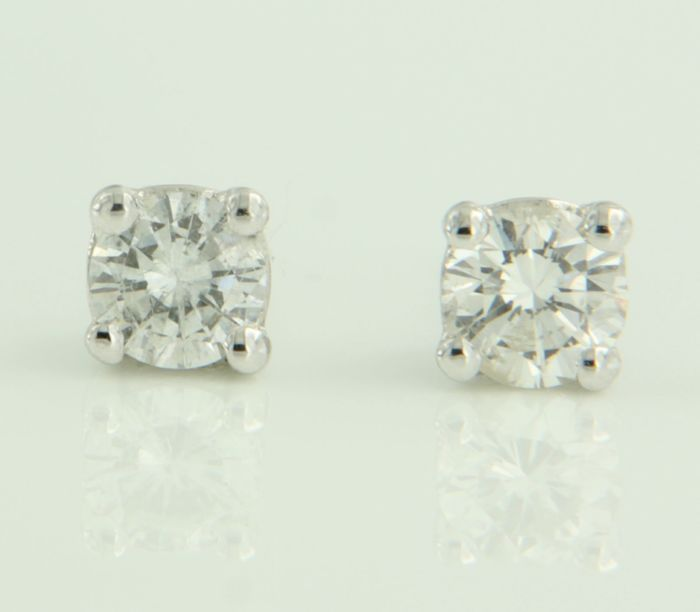 14k white gold solitaire ear studs set with brilliant cut diamond, total: 0.48 ct, width 4.3 mm