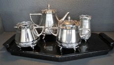 Silver plated coffee set on black wooden tray