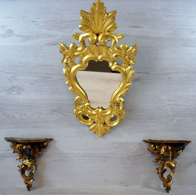 Gold-plated wooden mirror and two wall brackets.