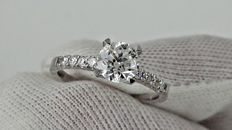 1.20 ct   round diamond  ring in white 14 K gold - size 7