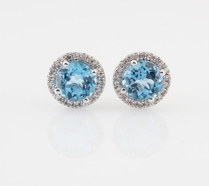 "18 kt white gold diamonds and Topaz earrings, 0.11 ct & 1.00 ct / 2.00 g / G-H VS1-VS2 / 15 x 8 x 8 mm / ""NEW"""