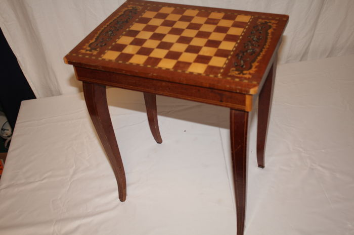 Chess table with music box